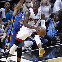 21 June 2012: Miami Heat shooting guard Dwyane Wade (3) goes to the basket against Oklahoma City Thunder point guard Russell Westbrook (0) during the Miami Heat 121-106 victory over the Oklahoma City Thunder, in Game 5 of the 2012 NBA Finals, at the AmericanAirlinesArena, Miami, Florida, USA. The Miami Heat wins the series 4-1.