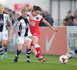 Notts County Laura Jayne tackles Bristol Academy Womens' Corinne Yorston - Photo mandatory by-line: Alex James/JMP - Mobile: 07966 386802 - 04/10/2014 - SPORT - Football - Bristol - Stoke Gifford Stadium - Bristol Academy Womens v Notts County Ladies - Womens Super League