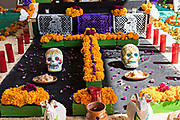 Traditional decorations on a Day of the Dead or Día de Muertos altar during the annual festival in San Miguel de Allende, Guanajuato, Mexico. The festival has been celebrated since the Aztec empire celebrates ancestors and deceased loved ones.