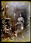 two woman standing in garden setting France circa 1920s