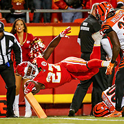 KANSAS CITY, MO - OCTOBER 21: Kareem Hunt #27 of the Kansas City Chiefs dives across the goal line for the second touchdown of the game during the second quarter of the game against the Cincinnati Bengals at Arrowhead Stadium on October 21, 2018 in Kansas City, Kansas. (Photo by David Eulitt/Getty Images)