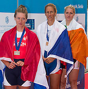 Belgrade, SERBIA,    A Finals Women's single sculls medals. left,  Silver medalist NED W1X, Chantel ACTERBURG, middle, Gold Medalist CZE W1X, Mirka KNAPKOVA and Right bronze medalist IRL W1X, Sanita PUSPUE at the 2014 FISA European Rowing Championships. Lake Sava. <br /> <br /> <br /> 14:45:07  Sunday  01/06/2014<br /> <br /> [Mandatory Credit; Peter Spurrier/Intersport-images]