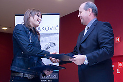 Sara Isakovic signed a contract with Borut Farcnik, SiSport d.o.o., at press conference when she has signed a contract with SI Sport, on December 22, 2008, Grand hotel Union, Ljubljana, Slovenia. (Photo by Vid Ponikvar / SportIda).