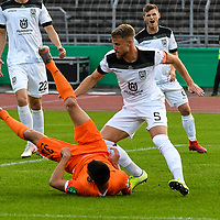 12.09.2020, Donaustadion, Ulm, GER, DFB Pokal, SSV Ulm 1846 Fussball vs FC Erzgebirge Aue, <br /> DFL REGULATIONS PROHIBIT ANY USE OF PHOTOGRAPHS AS IMAGE SEQUENCES AND/OR QUASI-VIDEO, <br /> im Bild Johannes Reichert (Ulm, #5) gewinnt den Kampf um den Ball gegen Ognjen Gnjatic (Aue, #33)<br /> <br /> Foto © nordphoto / Hafner