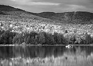 A pastoral mountain lake scene on an autumn evening, Loon Lake, Adirondack Mountains, New York State, USA