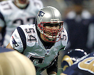 New England linebacker Tedy Bruschi (54) gets set for the snap of the ball, during the first quarter against the St. Louis Rams at the Edwards Jones Dome in St. Louis, Missouri, November 7, 2004.