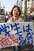 Tomoko Horanuchi student activist with Zengakuren (All Japan Federation of Students' Autonomous Body) at an anti war and left wing demo in Shibuya, Tokyo, Japan March 20th 2010
