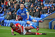Barnsley defender Dimitri Cavare (12) fouls Peterborough United midfielder Marcus Maddison (21) during the EFL Sky Bet League 1 match between Peterborough United and Barnsley at The Abax Stadium, Peterborough, England on 6 October 2018.