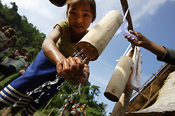 Plan International promotes an active WASH programme amongst the schools it works with in this district.  Lessons at school include this WASH component. In Teenpha village they have been making hand washing equipment. Teenpha village, Pha Oudom District, Bokeo Province, Lao PDR