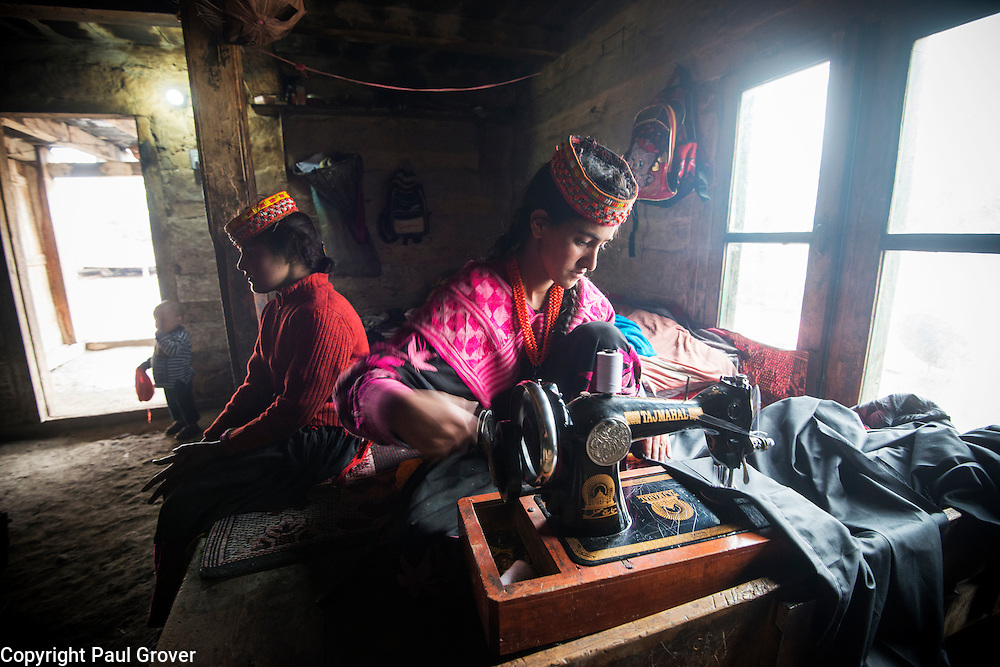 Bumburet, Chitral District,Pakistan.Pic Shows A Kalash woman in the Kalash village in the valley of Bumburet making some traditional clothing
