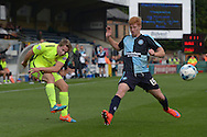 Connor Smith of Hartlepool United (l) crosses the ball past Ryan Sellers of Wycombe Wanderers. Skybet football league two match, Wycombe Wanderers v Hartlepool Utd at Adams Park in High Wycombe, Bucks on Saturday 5th Sept 2015.<br /> pic by John Patrick Fletcher, Andrew Orchard sports photography.