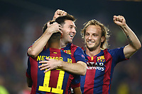 Lionel Messi and Ivan Rakitic (R) of FC Barcelona congratulate Neymar Jr as he just scored his side's opening goal during the UEFA Champions League, Group F, football match between FC Barcelona and Ajax Amsterdam on October 21, 2014 at Camp Nou Stadium in Barcelona, Spain. Photo MANUEL BLONDEAU / AOP PRESS / DPPI
