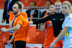 13-12-2019 JAP: Semi Final Netherlands - Russia, Kumamoto<br /> The Netherlands beat Russia in the semifinals 33-22 and qualify for the final on Sunday in Park Dome at 24th IHF Women's Handball World Championship / Bondscoach Emmanuel Mayonnade of Netherlands, Assistent Coach Ekaterina Andryushina of Netherlands, Dione Housheer #27 of Netherlands, Larissa Nüsser #9 of Netherlands