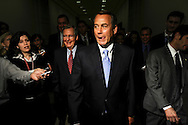 U.S. House Speaker John Boehner (R-OH) (C) and Senate Majority Leader Mitch McConnell (R-KY) (2nd L) are trailed by reporters after a news conference at the U.S. Capitol.
