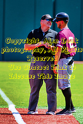 20 May 2019:  Tim Catton and the 1st base Saluki coach have some lighthearted words just before the game. Missouri Valley Conference Baseball Tournament - Southern Illinois Salukis v Illinois State Redbirds at Duffy Bass Field in Normal IL<br /> <br /> #MVCSPORTS