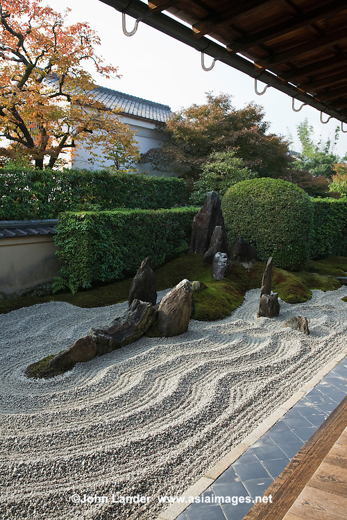 """Zuiho-in Zen Garden's most intriguing feature is its main rock garden called """"Dozuka-tei"""" which is raked into appealing patterns to suggest water ripples and waves lapping against rock formations representing the Hohrai Mountains. It was designed by Mirei Shigemori and is considered one of his most important modern Japanese gardens."""