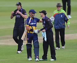 Michael Klinger of Gloucestershire congratulates Jacques Rudolph of Glamorgan on scoring a century - Photo mandatory by-line: Dougie Allward/JMP - Mobile: 07966 386802 - 12/06/2015 - SPORT - Cricket - Bristol - County Ground - Gloucestershire v Glamorgan - Natwest T20 Blast