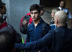 © Licensed to London News Pictures. 17/10/2016. Croydon, UK. A youth taken from the Calais jungle refugee camp boards a bus as he leaves the Home Office immigration centre in Croydon after being processed by officials. British authorities are bringing over about 100 children this week to be reunited with their relatives. The French government have announced that they will be dismantling the camp this month. credit: Peter Macdiarmid/LNP
