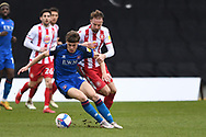 Carlisle United midfielder Taylor Charters (15) and Stevenage midfielder Chris Lines (40) battles for possession during the EFL Sky Bet League 2 match between Stevenage and Carlisle United at the Lamex Stadium, Stevenage, England on 20 March 2021.