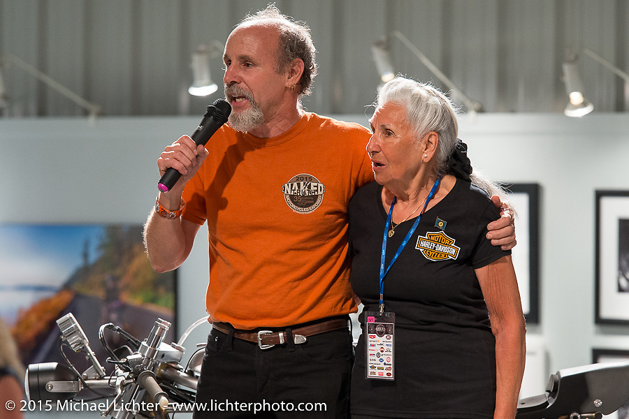 Michael LIchter introduces Gloria Struck who rode her HD Softail to Sturgis from Sturgis!, and then sings her Happy (90th) Birthday at the Naked Truth exhibition's industry party at the Buffalo Chip gallery during the 75th Annual Sturgis Black Hills Motorcycle Rally.  SD, USA.  August 5, 2015.  Photography ©2015 Michael Lichter.