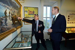 The Duke of Cambridge, known as the Earl of Strathearn in Scotland, with Lt Col Alexander Grant (Rtd), who is shown in a painting of the Aden Conflict in 1967, during a visit to Argyll and Sutherland Highlanders Regimental Museum at Stirling Castle.
