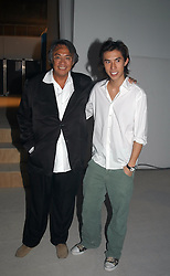 Left to right, DAVID TANG and his son EDWARD TANG at an exhibition of work by Rolf Sachs - a unique world-renowned contemporary furniture designer, held in association with the Louisa Guinness Gallery and held at 250 Brompron Road, London on 6th October 2004.<br />