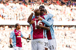 Aston Villa Forward Christian Benteke (BEL) hugs Midfielder Fabian Delph (ENG) and Defender Ryan Bertrand (ENG) as he celebrates scoring a goal - Photo mandatory by-line: Rogan Thomson/JMP - 07966 386802 - 23/03/2014 - SPORT - FOOTBALL - Villa Park, Birmingham - Aston Villa v Stoke City - Barclays Premier League.