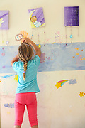 Young girl of 4 draws on her bedroom wall