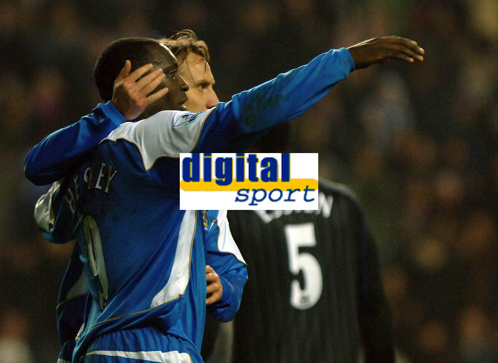 Photo: Paul Greenwood.<br />Wigan Athletic v Chelsea. The Barclays Premiership. 23/12/2006. Wigan's Emile Heskey, left, celebrates with Andreas Johansson