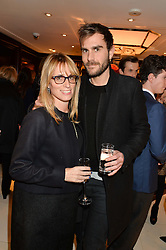 JANE SUITOR and OSCAR HUMPHRIES at a party to celebrate the publication of 'A Designer's Life' by Nicky Haslam held at Ralph Lauren, 1 New Bond Street, London on 19th November 2014.
