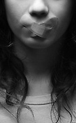 Silenced teen - Teenager with mouth taped close