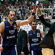 Efes Pilsen's Ermal KURTOGLU (L) and Ender ASLAN (C) celebrate victory during their Turkish Basketball league Play Off semi final second leg match Besiktas between Efes Pilsen at the BJK Akatlar Arena in Istanbul Turkey on Wednesday 12 May 2010. Photo by Aykut AKICI/TURKPIX