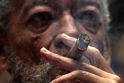 October 14, 2016 - FILE - The Obama administration announced today a new round of executive actions designed to increase trade and travel with the communist island. And this is the one many Americans have been waiting for, no more restrictions on the island's famed rum and cigars. Pictured: HAVANA, March 5, 2016 (Xinhua) -- A man smokes a cigar in the 15th Habanosommelier International Contest during the 18th International Habano Cigar Festival, in the city of Havana, capital of Cuba, on March 4, 2016. (Credit Image: © [E]Joaquin/Xinhua via ZUMA Wire)