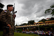 Soilders block protestors  supporting President Zelaya from clashing with protestors inside the Presidents house in Tegucigalpa on July 3, 2009. Zelaya is supposed to return this weekend, however the current government has promised to put him in jail if he enters the country.