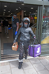 ©Licensed to London News Pictures 13/05/2020<br /> Welling, UK. A deliveroo driver collecting food from Welling McDonalds in South East London. Some McDonalds restaurants in the UK have opened today from 11am for McDelivery service only after being closed for weeks due to the Coronavirus lockdown. Photo credit: Grant Falvey/LNP