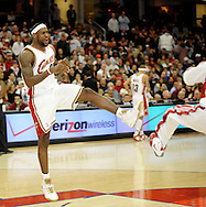 LeBron James and Damon Jones of Cleveland play around during pregame ceremonies before a game against visiting Memphis.