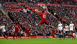 Liverpool's Sadio Mane heads the ball into the penalty area during the Premier League match at Anfield, Liverpool.