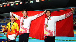 JAKARTA, Aug. 24, 2018  Gold medalist Sun Yang (C) of China and bronze medalist Ji Xinjie (R) of China pose for pictures after the awarding ceremony of men's 1500m freestyle final of swimming at the 18th Asian Games in Jakarta, Indonesia, Aug. 24, 2018. (Credit Image: © Fei Maohua/Xinhua via ZUMA Wire)