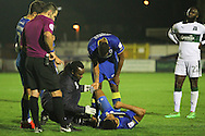 AFC Wimbledon striker Lyle Taylor (33) gets treatment during the EFL Trophy match between AFC Wimbledon and Plymouth Argyle at the Cherry Red Records Stadium, Kingston, England on 4 October 2016. Photo by Stuart Butcher.