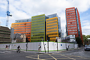 Multicoloured office of Google on St Giles High Street with an open construction site in the plot immediately behind their offices on 16th July 2020 in London, United Kingdom. Google is an American multinational technology company specializing in Internet-related services and products.