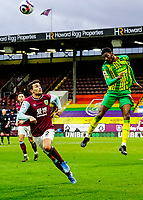 West Bromwich Albion's Ainsley Maitland-Niles heads the ball clear with Burnley's Matthew Lowton<br /> <br /> Photographer Lee Parker/CameraSport<br /> <br /> The Premier League - Burnley v West Bromwich Albion - Saturday 20th February 2021 - Turf Moor - Burnley<br /> <br /> World Copyright © 2021 CameraSport. All rights reserved. 43 Linden Ave. Countesthorpe. Leicester. England. LE8 5PG - Tel: +44 (0) 116 277 4147 - admin@camerasport.com - www.camerasport.com