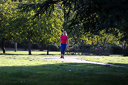 © Licensed to London News Pictures. 10/09/2020. London, UK. A woman walking in Finsbury Park, north London. Met Office forecasts a mini heatwave in the South East. Photo credit: Dinendra Haria/LNP
