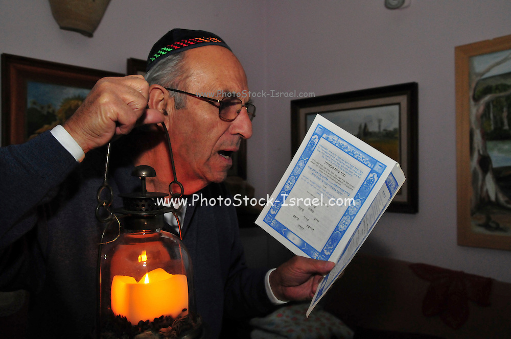 Passover, Searching for Chametz (leavened products that are forbidden to be consumed on the Jewish holiday of Passover) on Passover eve. Traditionally done with a candle and feather