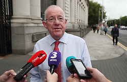 Minister for Foreign Affairs Charlie Flanagan arrives at Government Buildings, Dublin, on what is outgoing Taoiseach Enda Kenny's final day.