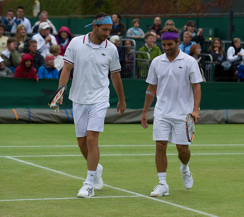 Amaud Clement FRA and Michael Llodra in action during their Gentlemen's Doubles Third Round match against Bob Btyan USA and Mike Bryan USA..Tennis - Wimbledon Lawn Tennis Championships - Day 8 - Tuesday 3rd July 2012 -  All England Lawn Tennis and Croquet Club - Wimbledon - London - England...