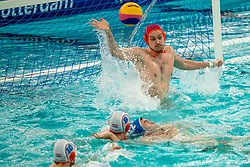 Eelco Wagenaar of the Netherlands in action against Levente Vancsik of Romania during the Olympic qualifying tournament. The Dutch water polo players are on the hunt for a starting ticket for the Olympic Games on February 16, 2021 in Rotterdam