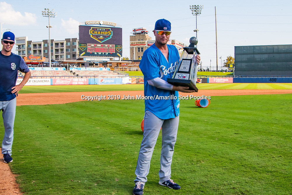 Amarillo Sod Poodles catcher A.J. Kennedy (8) poses with the trophy after the Sod Poodles won against the Tulsa Drillers during the Texas League Championship on Sunday, Sept. 15, 2019, at OneOK Field in Tulsa, Oklahoma. [Photo by John Moore/Amarillo Sod Poodles]
