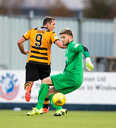 Falkirk's keeper Danny Rogers tackles Alloa Athletic's Michael Chopra. <br /> Falkirk 5 v 0 Alloa Athletic, Scottish Championship game played at The Falkirk Stadium.