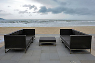 Deserted sofas along a waterfront beach in Danang, Vietnam, Southeast Asia