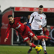 Besiktas's Simao Sabrosa (R) and Gaziantepspor's Ismael Sosa (L) during their Turkish superleague soccer match Besiktas between Gaziantepspor at BJK Inonu Stadium in Istanbul Turkey on Tuesday, 05 January 2012. Photo by TURKPIX